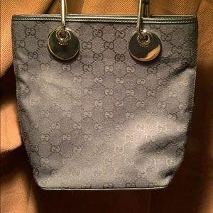Gucci Iconic G pattern textile/leather mini bag